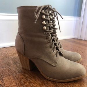Faux Suede boots that tie and zip up. Size 7